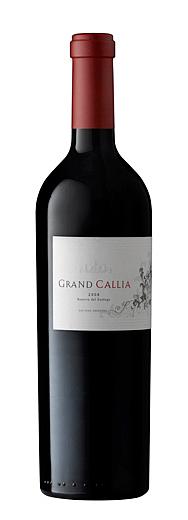 fotografía de botella de vino tinto
